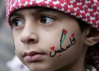 A-boy-with-the-word-PALESTINE-written-on-his-face-takes-part-in-a-protest-against-the-Israeli-blockade-of-the-Gaza-Strip-in-Amman-December-5-2008-Reuters