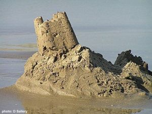 Would that our prison industrial complex could disappear like this sand castle